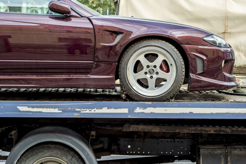 Tow trucks after the accident transports the car brand Nissan